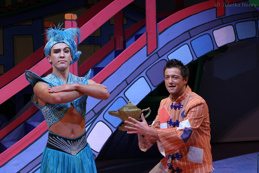 Tom Woods as genie of the lamp and Chris Till  as Aladdin