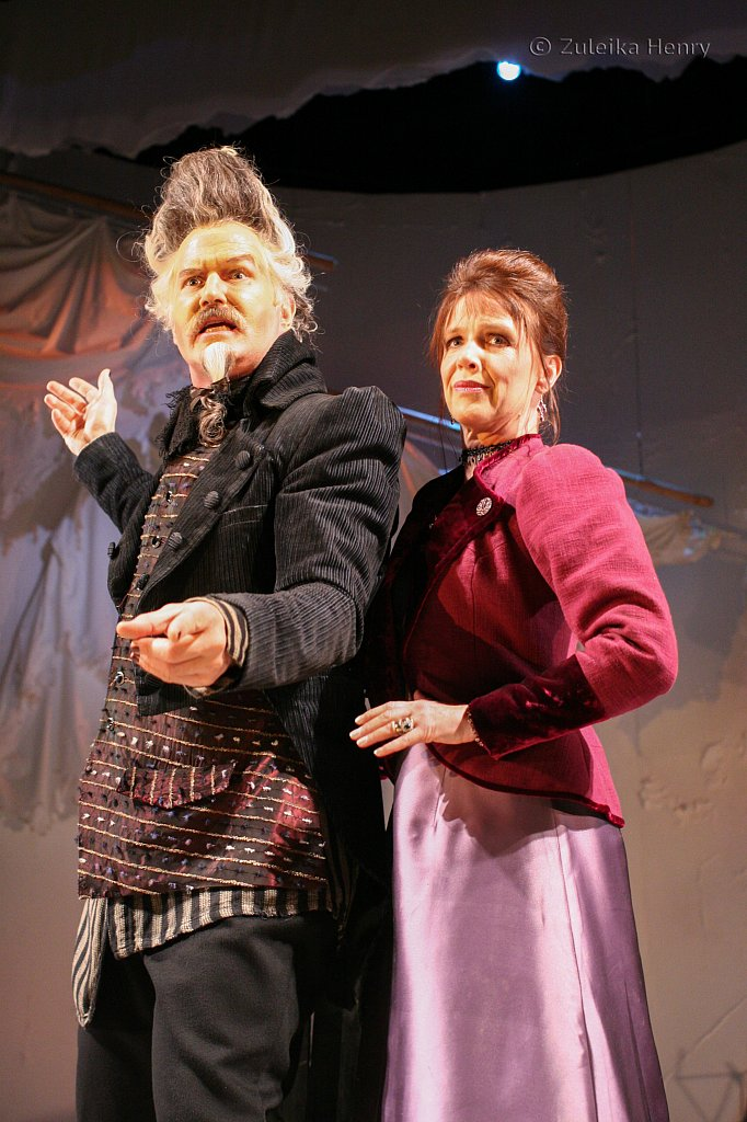 Tom Hodgkins as Dr. Pinch and Suzanne Burden as Adriana