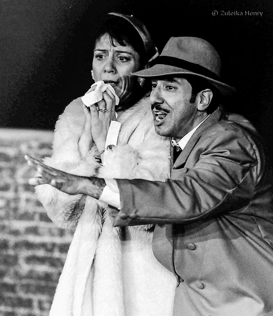 Andrew Rivera as Nathan Detroit and Mary King as Miss Adelaide