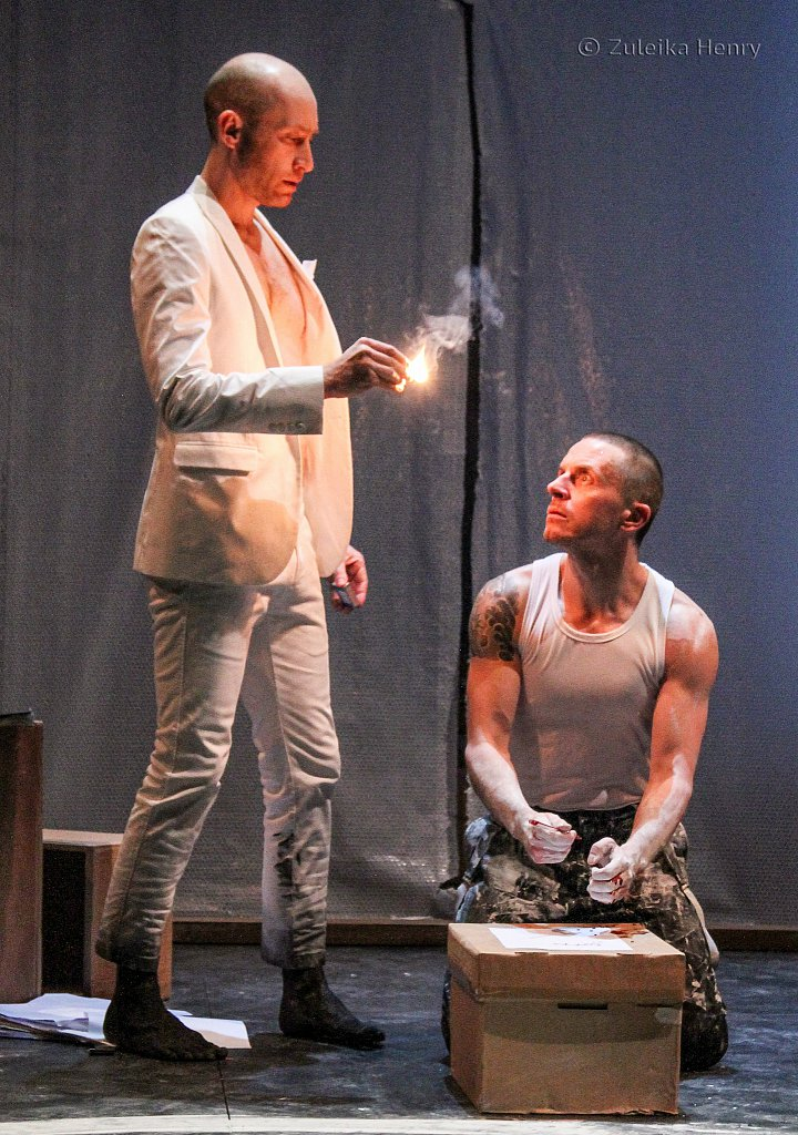 Sandy Grierson as Mephistophilis nd Oliver Ryan as Doctor Faustus