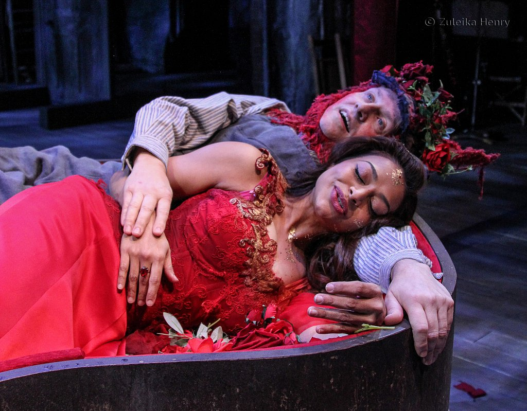 Ayesha Dharker as Titania and Chris Clark as Bottom