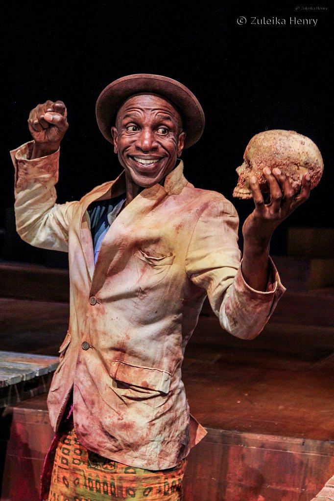 Ewart James Walters as Gravedigger