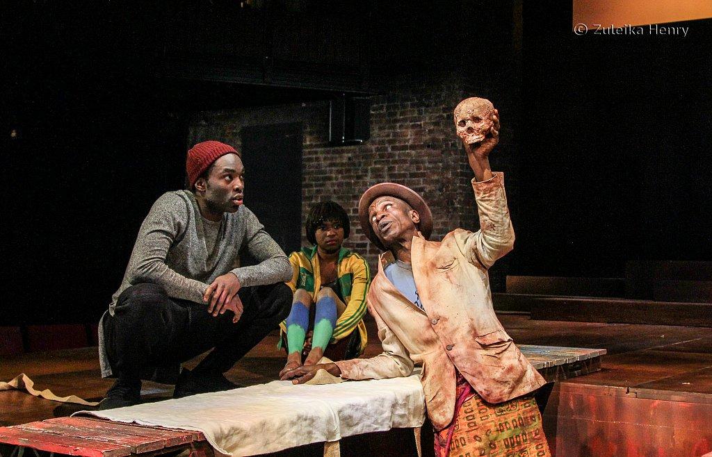 Paapa Essiedu as Hamlet, Temi Wilkey as Gravedigger's assistant and Ewart James Walters as Gravedigger
