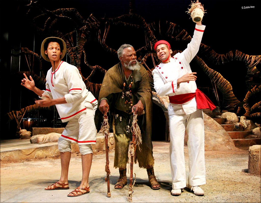 Wayne-van-Royen-as-Triculo-Elton-Landrew-as-Stephano-and-John-Kani-as-Caliban.jpg